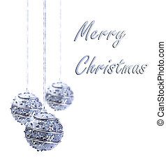 Silver Christmas baubles hanging from silver string isolated...