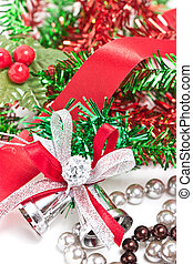 Silver Christmas bells decorating with red ribbon.