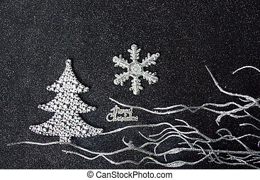 Silver Christmas decorations on dark background