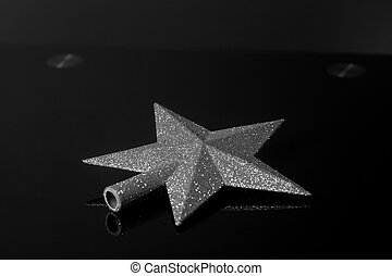 Silver Christmas Star isolated on black background