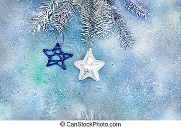 silver christmas tree branch with stars on blue background