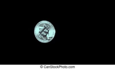 Silver coin falls down on black slow motion