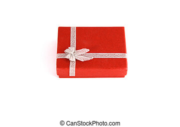 Silver color bow ribbon on red background