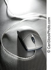Silver computer wired mouse over metal steel background