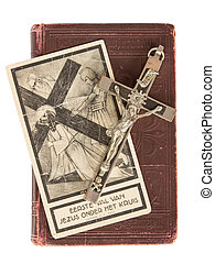 Silver cross and old holy bible