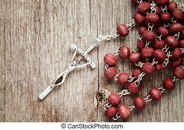 Silver cross crucifix on wooden background