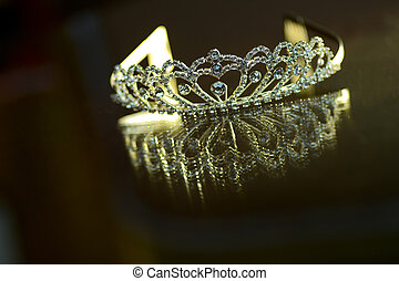 Silver crown with stones and reflection
