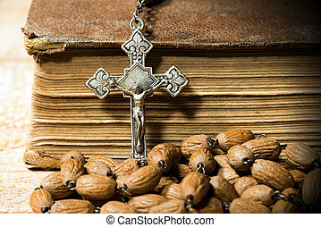 Silver Crucifix Rosary Bead and Holy Bible