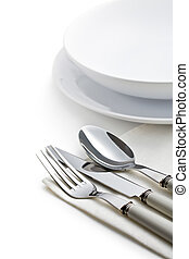 silver cutlery and plates