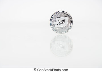 Silver Dash coin with reflection on the table, online digital currency. Concept of block chain, market uprise
