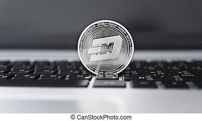 Silver Dash Cryptocurrency on laptop keyboard. Virtual...