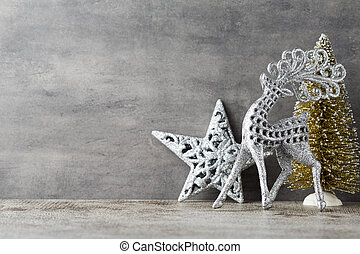 Silver deer on gray background. Christmas background.