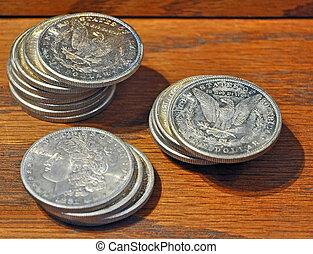 Silver Dollars hidden away in an Old Wooden Desk Drawer.