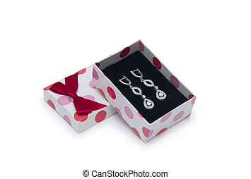 Silver earrings in a box isolated on white background