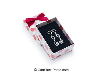Silver earrings in a box on white background