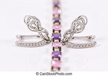 silver earrings in the shape of  horseshoe and silver bracelet