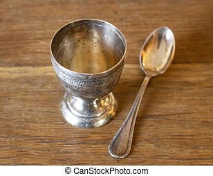 silver egg cup and egg