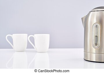 Silver Electric Kettle - A studio photo of an electric...