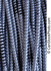 Silver Electrical Wire - Strands of electrical wire cross...