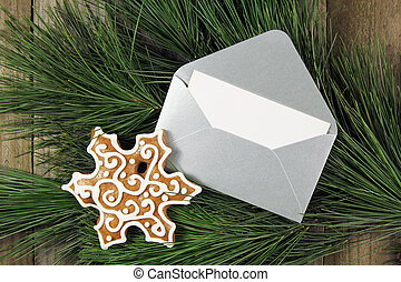 silver envelope with gingerbread on christmas fir tree