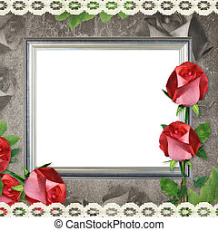 silver frame on old paper background and roses