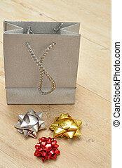 Silver gift bag with a variety of colorful bows