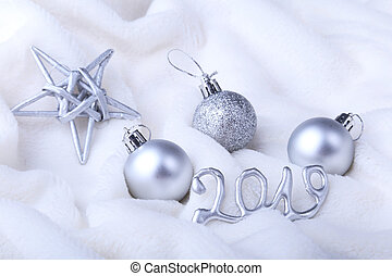 Silver gift box with ribbon bow and Christmas balls on white. Decoration for happy holidays.