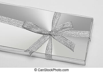 silver gift box with ribbon