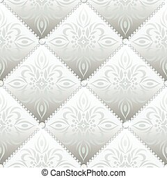 Silver glamor satin quilted seamless texture of fabric with diamond buttons and classic pattern