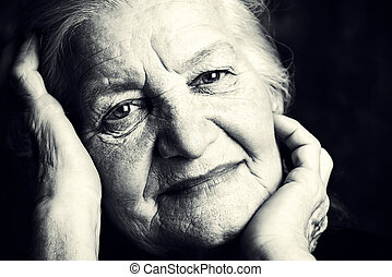 silver hair - Portrait of a beautiful smiling senior woman....