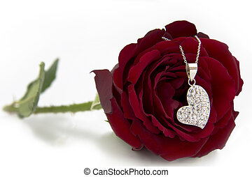 Silver Heart Necklace hanging on Rose
