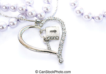 Silver heart with key,lock,pink pearls on white background.