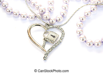 Silver heart,key,lock, pearls isolated on white background.