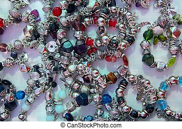 silver jewellery blacelets shop display colorful stones