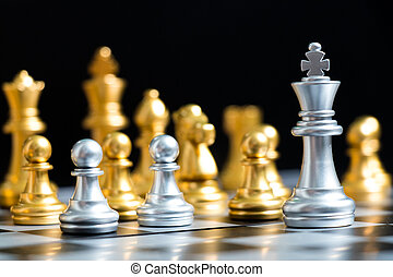 Silver king chess piece face with another gold team (Concept for company strategy, business decision and encounter the problem)