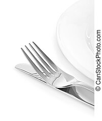 silver knife and fork on plate