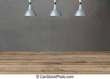 Silver lamps on the ceiling and a backdrop on a concrete wall with brown wood floor.