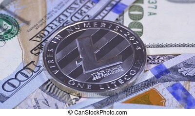 Silver Litecoin Coin, LTC and Bills of Dollars are Rotating