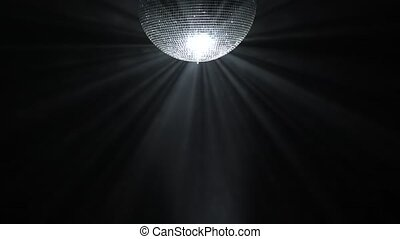 Silver mirror disco ball rotating in black space