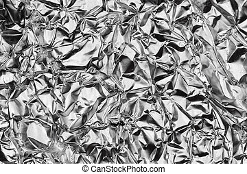Silver Monochrome Crumpled Foil Texture. Metallic Black & White Background.