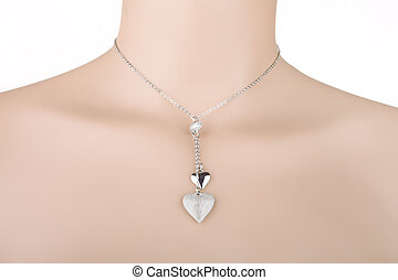 Silver necklace with two heart pendants on a mannequin