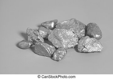 silver nuggets on gray background
