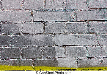 Silver painted graffiti brickwall