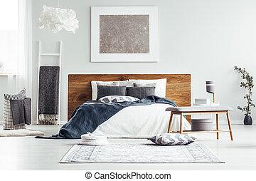 Silver painting in designer bedroom