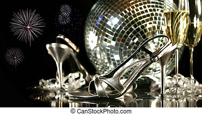 Silver party shoes with champagne glasses against a party...