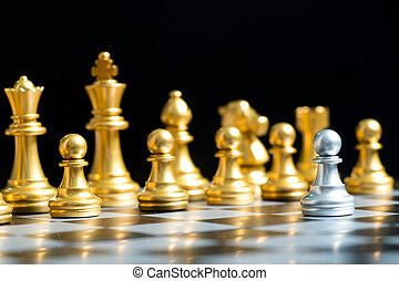 Silver pawn chess piece face with another gold team (Concept for company strategy, business decision and encounter the problem)