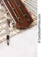 pen at sheet of music