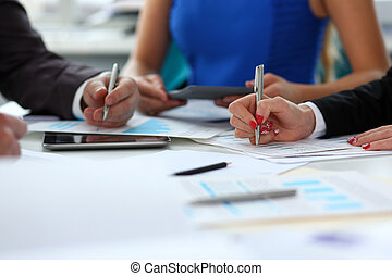Silver pen lie on important paper at table