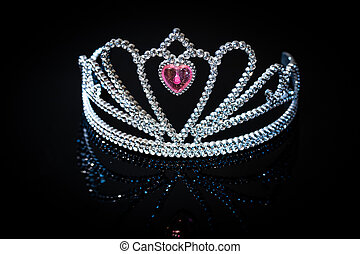 Silver princess crown on the black background
