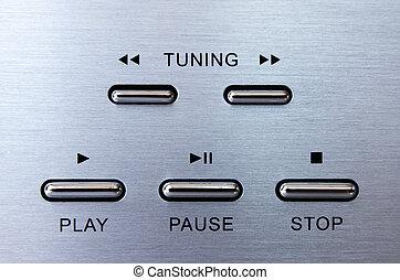 Silver remote control playback keypad with black symbol